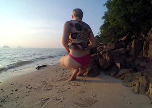 Obese little girl jacking on the beach
